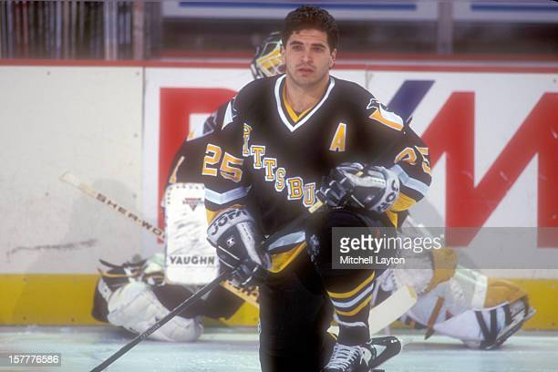 Kevin Stevens of the Pittsburgh Penguins looks on before a hockey game against the Washington Capitals on January 29 1995 at USAir Arena in Landover...