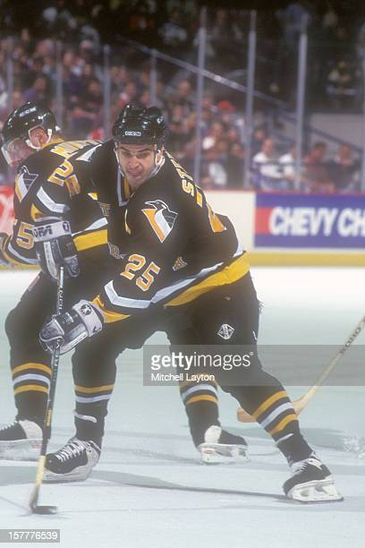 Kevin Stevens of the Pittsburgh Penguins stakes with the puck a hockey game against the Washington Capitals on January 29 1995 at USAir Arena in...