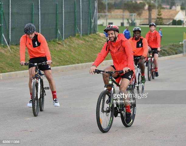 Kevin Stewart and Connor Randall of Liverpool arrive on a bikes before the training session at La Manga on February 16 2017 in La Manga Spain