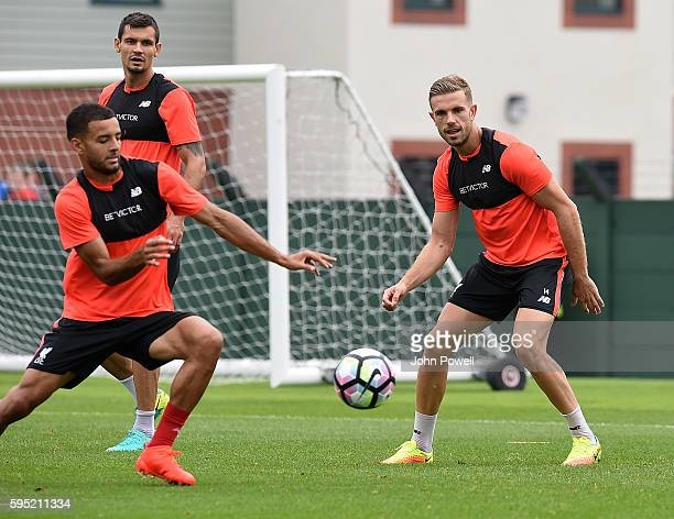 Kevin Stewart and Jordan Henderson of Liverpool during a training session at Melwood Training Ground on August 25 2016 in Liverpool England