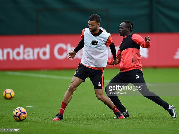 Kevin Stewart and Sadio Mane of Liverpool during a training session at Melwood Training Ground on December 2 2016 in Liverpool England