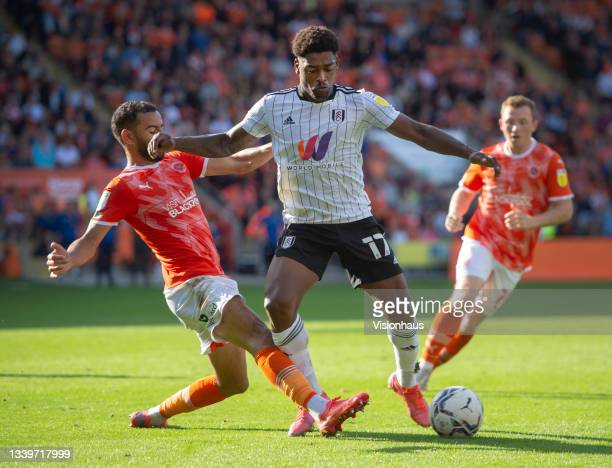 Kevin Stewart and Shayne Lavery of Blackpool with Ivan Cavaleiro of Fulham in action during the Sky Bet Championship match between Blackpool and...
