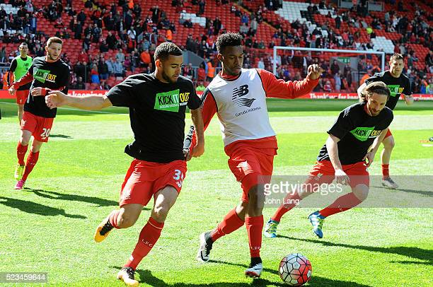 Kevin Stewart, Daniel Sturridge and Joe Allen of Liverpool warm up before the Barclays Premier League match between Liverpool and Newcastle United at...