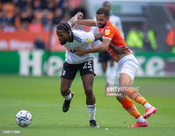 Kevin Stewart of Blackpool and Josh Onomah of Fulham in action during the Sky Bet Championship match between Blackpool and Fulham at Bloomfield Road...