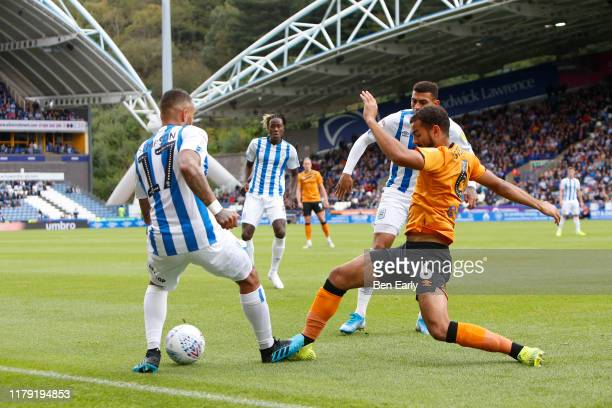 Kevin Stewart of Hull City challenges Danny Simpson of Huddersfield Town during the Sky Bet Championship match between Huddersfield Town and Hull...