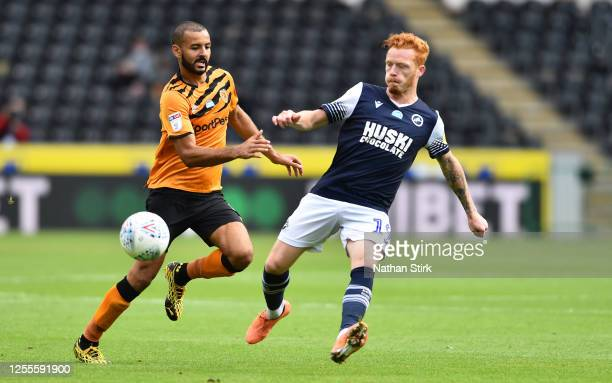Kevin Stewart of Hull City challenges Ryan Woods of Millwall for the ball during the Sky Bet Championship match between Hull City and Millwall at...
