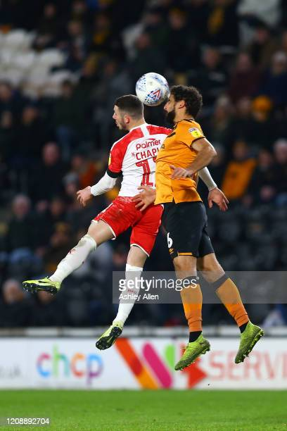 Kevin Stewart of Hull City wins a header from Conor Chaplin of Barnsley FC during the Sky Bet Championship match between Hull City and Barnsley at...