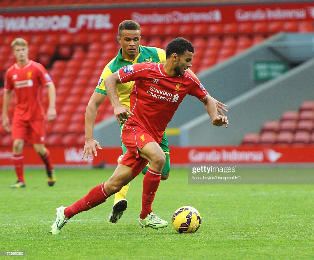 Kevin Stewart of Liverpool and Carlton Morris of Norwich City in action during the U21 Premier League match between Liverpool and Norwich City at Anfield on May 11, 2015 in Liverpool, England.