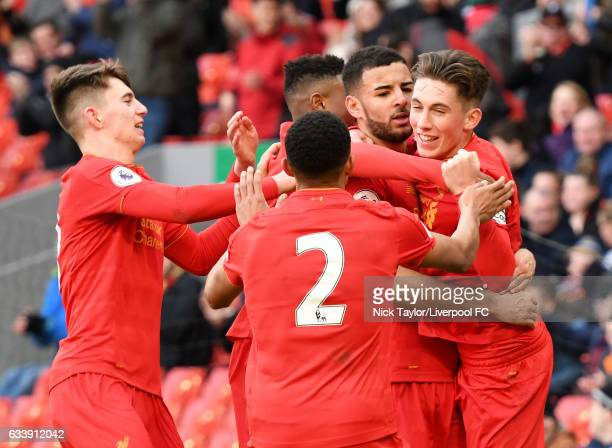 Kevin Stewart of Liverpool celebrates his goal with team mates Ben Woodburn Rhian Brewster Trent AlexanderArnold and Harry Wilson during the...