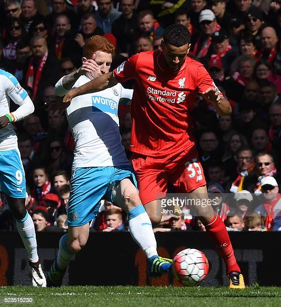 Kevin Stewart of Liverpool competes with Jack Colback of Newcastle United during the Barclays Premier League match between Liverpool and Newcastle...