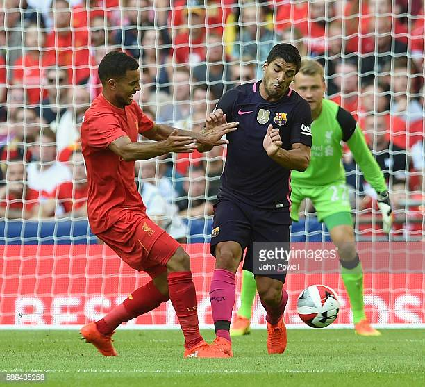 Kevin Stewart of Liverpool competes with Luis Suarez of Barcelona during the International Champions Cup match between Liverpool and Barcelona at...
