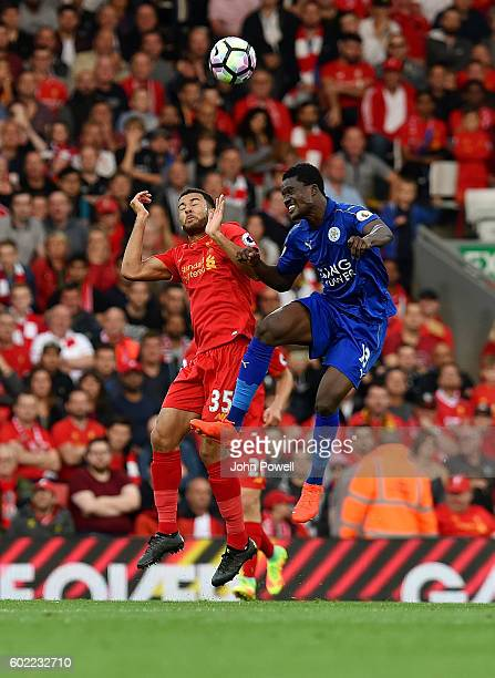 Kevin Stewart of Liverpool goes up with Daniel Amartey of Leicester City during the Premier League match between Liverpool and Leicester City at...