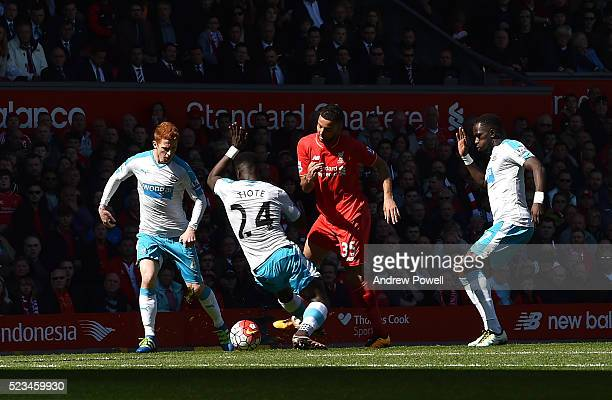Kevin Stewart of Liverpool is surrounded by Newcastle players during the Barclays Premier League match between Liverpool and Newcastle United at...