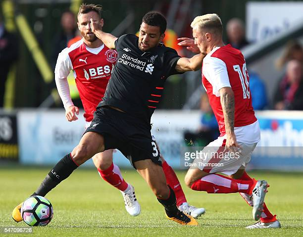 Kevin Stewart of Liverpool wins the ball ahead of David Ball of Fleetwood Town during the PreSeason Friendly match between Fleetwood Town and...
