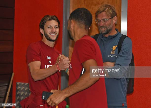 Kevin Stewart of Liverpool with Adam Lallana of Liverpool on his return to Melwood for his first day back at Melwood Training Ground on July 11, 2017...