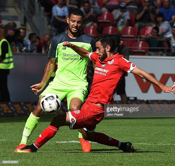 Kevin Stewart of Liverpool with Yunus Malli of Mainz during the game at Opel Arena on August 7, 2016 in Mainz, Germany.