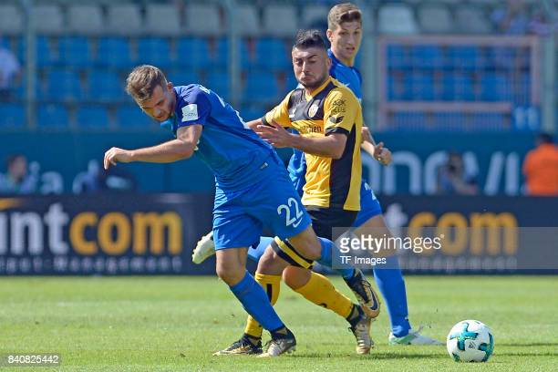 Kevin Stöger of Bochum and Aias Aosman of Dresden battle for the ball during the Second Bundesliga match between VfL Bochum 1848 and SG Dynamo...