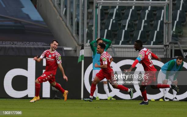 Kevin Stoeger of 1. FSV Mainz 05 celebrates with teammates Phillipp Mwene and Moussa Niakhate after scoring his team's second goal during the...