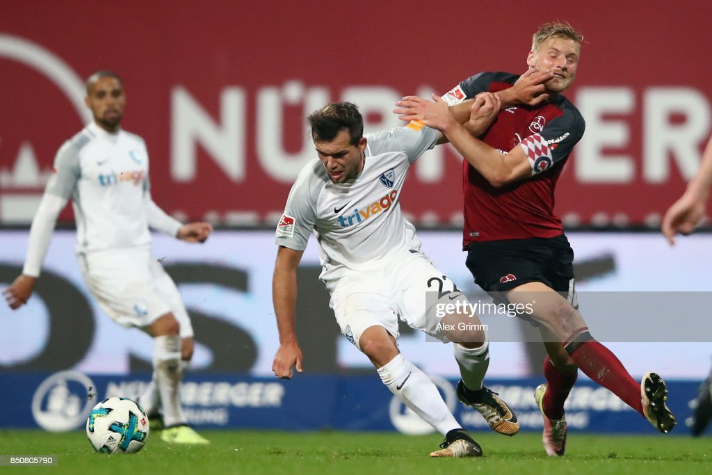 Kevin Stoeger of Bochum is challenged by Hanno Behrens of Nuernberg during the Second Bundesliga match between 1. FC Nuernberg and VfL Bochum 1848 at Max-Morlock-Stadion on September 21, 2017 in Nuremberg, Germany.