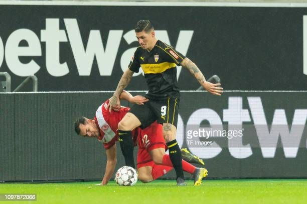 Kevin Stoeger of Duesseldorf and Steven Zuber of Stuttgart battle for the ball during the Bundesliga match between Fortuna Duesseldorf and VfB...