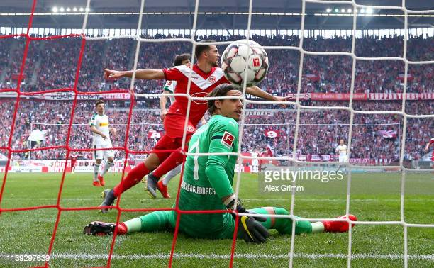 Kevin Stoger of Fortuna Duesseldorf celebrates after scoring his team's second goal as Yann Sommer of Borussia Monchengladbach reacts during the...
