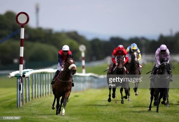 Kevin Stott riding Sadmah on their way to winning the Steve Taplin Memorial EBF Fillies' Novice Stakes at Haydock Park Racecourse on June 9, 2021 in...