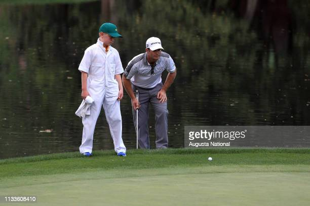 Kevin Streelman and his caddie Ethan Couch line up a putt on the No 9 green during the Par 3 Contest for the Masters at Augusta National on Wednesday...