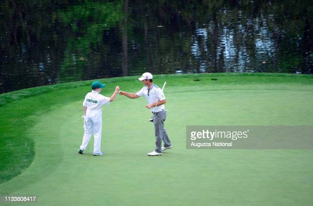 Kevin Streelman celebrates with his caddie Ethan Couch on the No 9 to win in a playoff during the Par 3 Contest for the Masters at Augusta National...