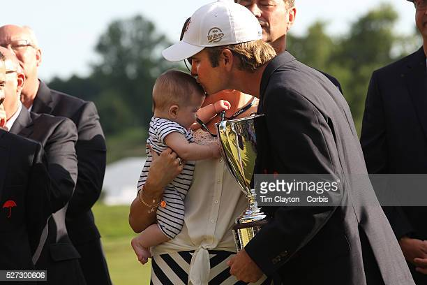 Kevin Streelman kisses his 6monthold daughter Sophia watched by his wife Courtney after winning the Travelers Championship at the TPC River Highlands...