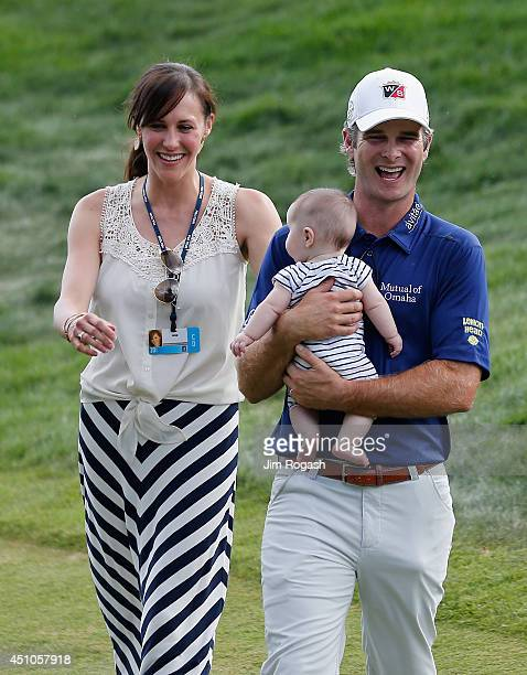 Kevin Streelman of the United States holds daughter Sophia with wife Courtney after winning the Travelers Championship golf tournament at the TPC...