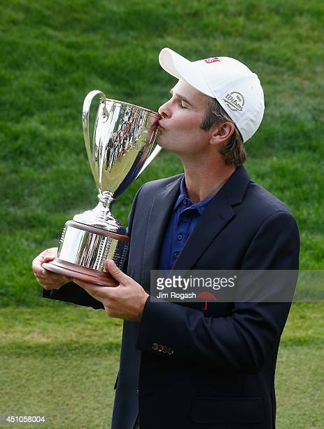 Kevin Streelman of the United States kisses the trophy after winning the Travelers Championship golf tournament at the TPC River Highlands on June 22...