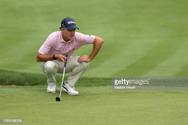 Kevin Streelman of the United States lines up a putt on the 17th green during the final round of the Travelers Championship at TPC River Highlands on...