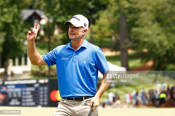 Kevin Streelman of the United States waves on the 18th green during the final round of the Wyndham Championship at Sedgefield Country Club on August...