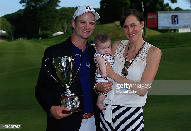 Kevin Streelman of the United States with daughter Sophia and wife Courtney after winning the Travelers Championship golf tournament at the TPC River...
