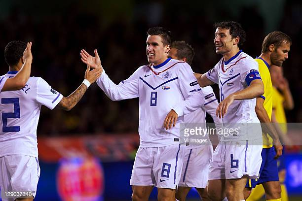 Kevin Strootman and Mark van Bommel of Holland during the EURO 2012 Qualifying match between Sweden and Netherlands at the Rasunda stadium on October...