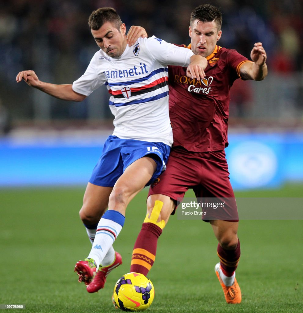 Kevin Strootman (R) of AS Roma competes for the ball with Pavel Wszolek of UC Sampdoria during the Serie A match between AS Roma and UC Sampdoria at Stadio Olimpico on February 16, 2014 in Rome, Italy.