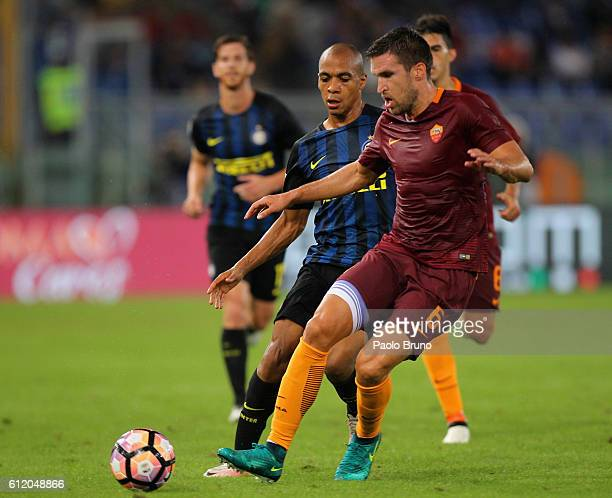 Kevin Strootman of AS Roma competes with Joao Mario of FC Internazionale during the Serie A match between AS Roma and FC Internazionale at Stadio...