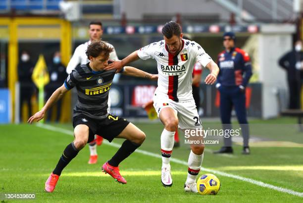Kevin Strootman of Genoa is challenged by Nicolo Barella of Internazionale during the Serie A match between FC Internazionale and Genoa CFC at Stadio...