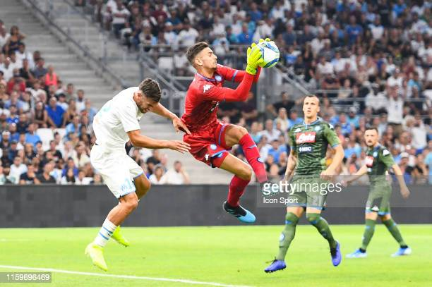 Kevin Strootman of Marseille and Alex Meret of Napoli during the Friendly match between Marseille and Napoli at Stade Velodrome on August 4 2019 in...