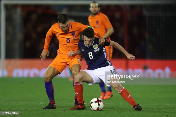 Kevin Strootman of Netherlands vies with John McGinn of Scotland during the International Friendly between Scotland and Netherlands at Pittodrie...