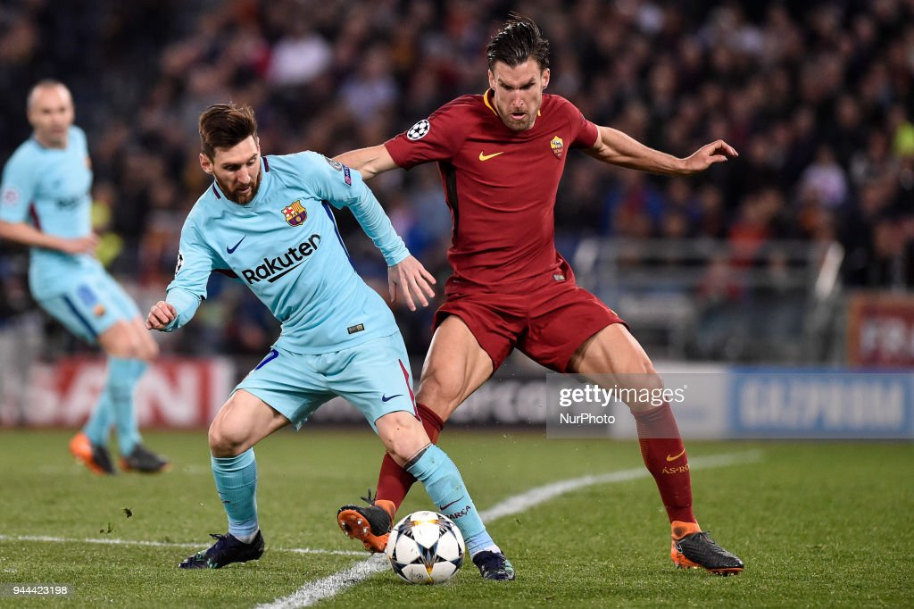 Kevin Strootman of Roma challenges Lionel Messi of FC Barcelona during the UEFA Champions League Quarter Final match between Roma and FC Barcelona at Stadio Olimpico, Rome, Italy on 10 April 2018.