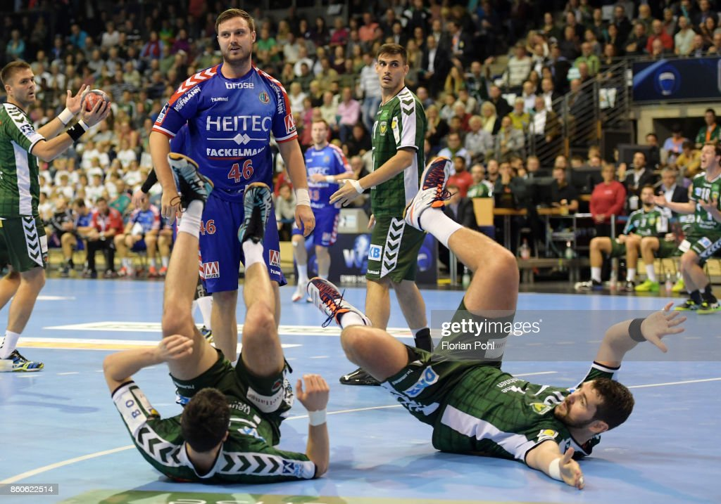 Kevin Struck of Fuechse Berlin, Jonas Thuemmler of HC Erlangen, Ignacio Plaza Jimenez and Jakov Gojun of Fuechse Berlin during the game between Fuechse Berlin and the HC Erlangen on September 12, 2017 in Berlin, Germany.