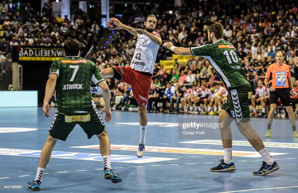 Kevin Struck of Fuechse Berlin, Patrick Weber of the Eulen Ludwigshafen and Jakov Gojun of Fuechse Berlin during the game between Fuechse Berlin and the Eulen Ludwigshafen on September 3, 2017 in Berlin, Germany.