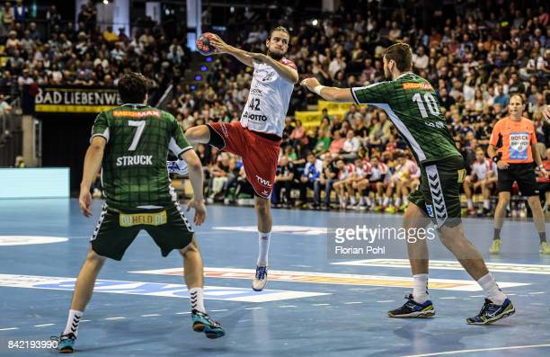 Kevin Struck of Fuechse Berlin Patrick Weber of the Eulen Ludwigshafen and Jakov Gojun of Fuechse Berlin during the game between Fuechse Berlin and...