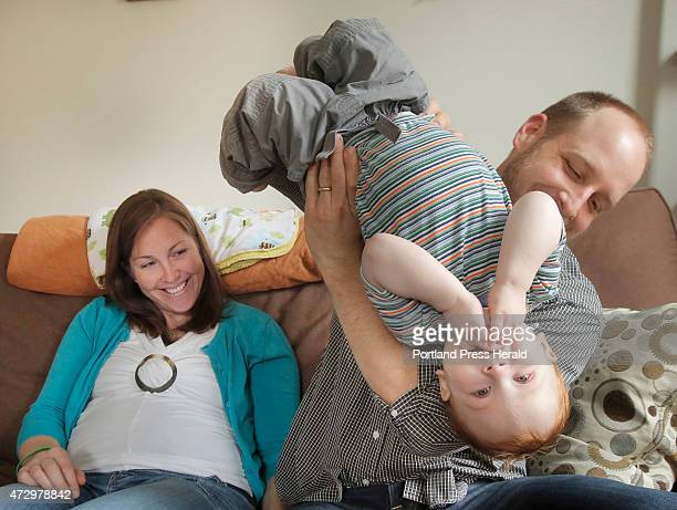Kevin Sturtevant of Portland spins his 19month old son Sam while his wife Maureen watches on Saturday May 9 2015 Sam had a liver transplant when he...