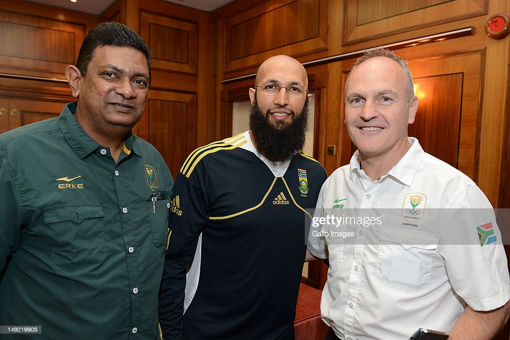 Kevin Subban, Hashim Amla and Shane Keohane (Teams SA Media Liason) during the South African Olympic Team Press Conference from Copthorne Tara Hotel, Kensington on July 25, 2012 in London, England.