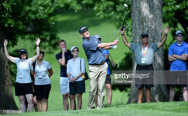 Kevin Sutherland chips onto the 18th green on the second playoff hole during the final round of the Principal Charity Classic at the Wakonda Club on...