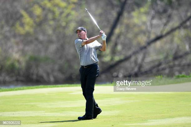 Kevin Sutherland hits his approach shot on the 14th hole during the second round of the Senior PGA Championship presented by KitchenAid at the Golf...