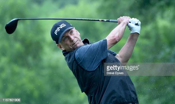 Kevin Sutherland hits his tee shot on the 18th hole during the final round of the American Family Insurance Championship at the University Ridge Golf...