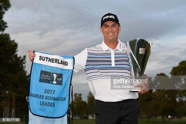 Kevin Sutherland holds the Charles Schwab Cup after winning the PGA TOUR Champions Charles Schwab Cup Championship at Phoenix Country Club on...
